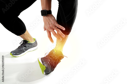 Runner sportsman holding ankle in pain with Broken twisted joint running sport i Wallpaper Mural