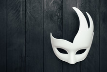 White Carnival Mask On Black Wooden Wall. Swan. Empty Space.