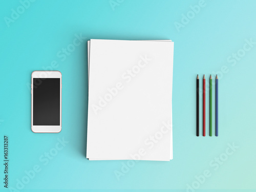 Minimal Office Desk Workplace With Blank Paper, Smartphone, Pencil And Pen  Copy Space On
