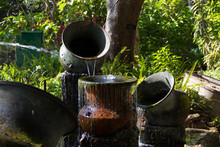 Waterfall From A Clay Jar