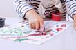 little girl learning to paint (child development in art)
