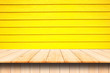 canvas print picture -  wooden deck table top and wooden yellow wall Background.