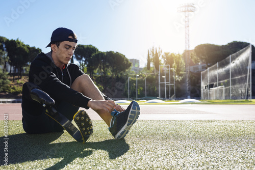 Disabled man athlete ready for training with leg prosthesis. Canvas Print