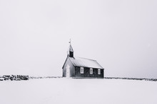 Beautiful Minimalistic View Of Budir Black Church In The Snaefellsnes Peninsula During Severe Snowstorm