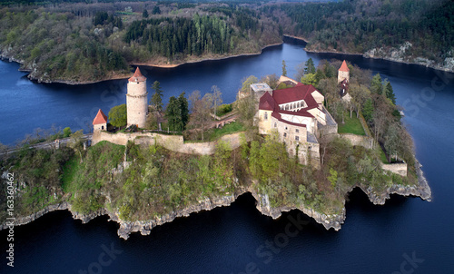 Photo  Aerial view on czech medieval secular castle Zvikov, situated on rocky outcrop above the confluence of two rivers in the centre of beautiful, spring nature