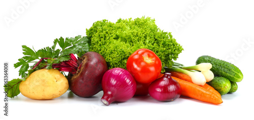 Assortment of fresh raw vegetables isolated on white background. Tomato, cucumber, onion, salad, carrot, beetroot, potato
