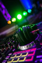 Fototapeta na wymiar Dj mixer with headphones at a nightclub
