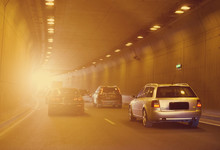 Cars Driving Through The Tunnel.