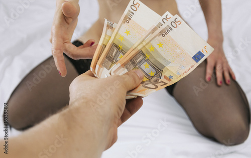 Prostitute takes money for her work. Fototapet
