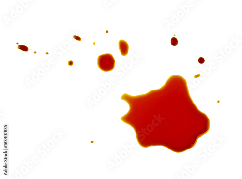 Puddle of soy sauce isolated on a white background