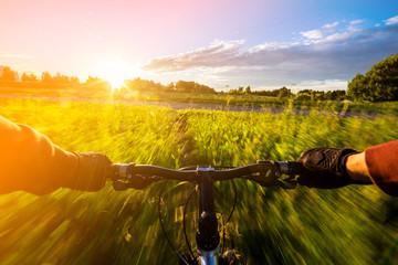 Fototapeta na wymiar Mountain biking down hill descending fast on bicycle.