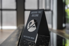No Smoking Sign On A Shelf Of Hotel Room. Concept Photo Of Banning Smoking In Public Area, Medical, Health, Free Smoking, Hazard And Addiction.