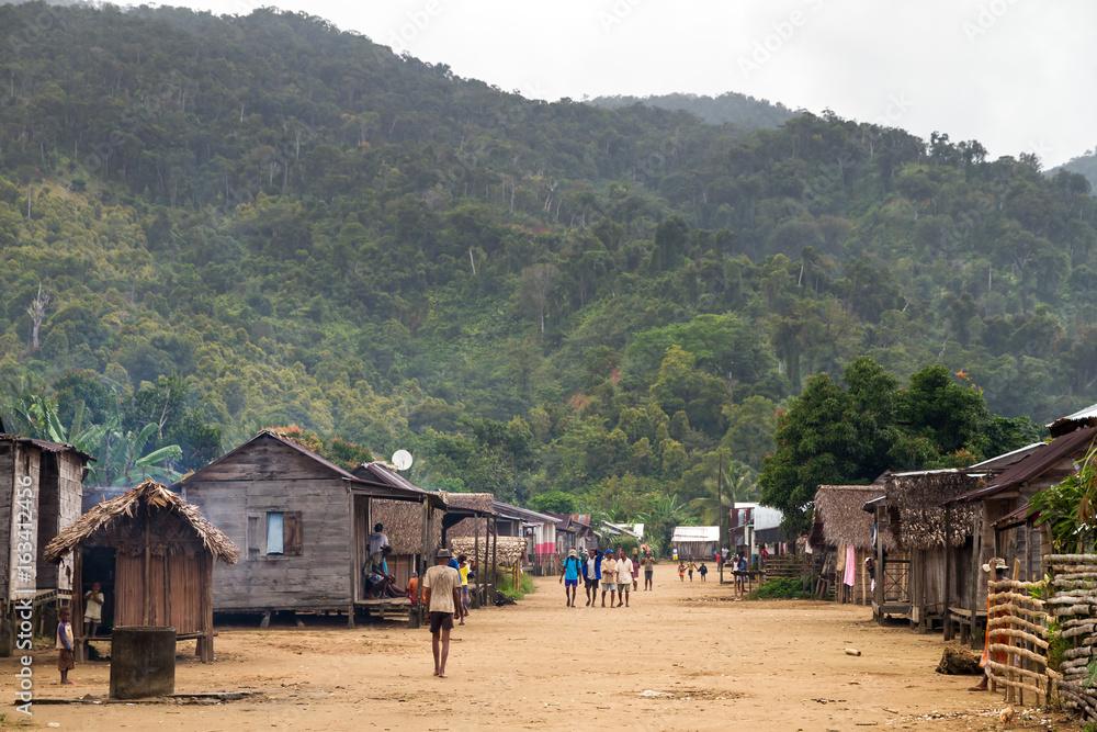 Fototapeta Local people walking around in the village of Benjana, Madagascar, on September 22, 2013