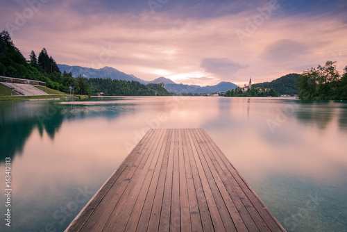 Spoed Foto op Canvas Lavendel Wooden deck leading into Bled lake,Slovenia