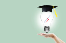 Hand Holding Light Bulb With Certification For Graduation Shows The Ingenuity Intelligence Knowledge And Success For Education