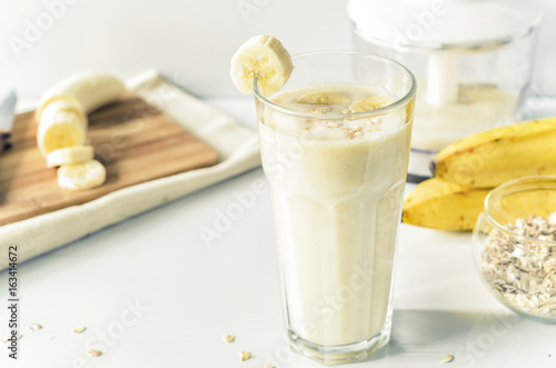 Spoed Foto op Canvas Milkshake Milkshake with banana and oatmeal , healthy breakfast