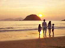 Asian Family Watching Sunrise ...