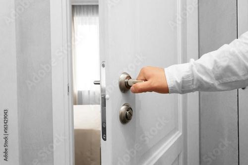 Photo  Man open the door