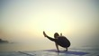 Young girl slim black wear do yoga Firefly pose sunrise fog rapid slow motion