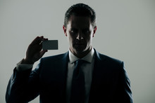 Shadow Business, Businessman Holding Bank Or Business Card