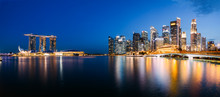 Panoramic Photograph Of Singapore Skyline At Night. Central Business District, Fullerton Park At The Newly Built Jubilee Bridge.