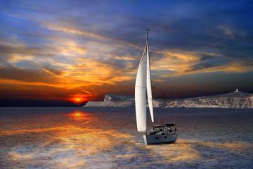 Fototapeta na wymiar Sailboat Sailing on the Mediterranean sea during the sunset