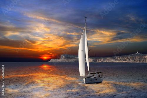Obrazy na płótnie Canvas Sailboat Sailing on the Mediterranean sea during the sunset