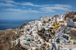 Day time view over the whitewashed buildings and windmill of Oia from the castle walls, Santorini, Cyclades, Greek Islands, Greece, Europe