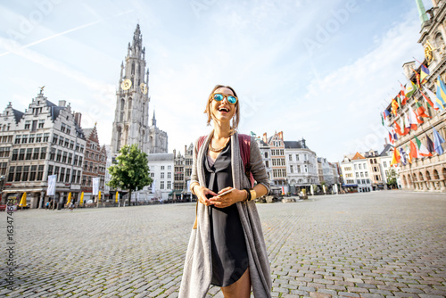 Recess Fitting Antwerp Young woman tourist walking on the Great Market square during the morning in Antwerpen, Belgium