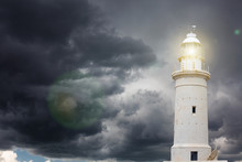 Lighthouse Beaming Light Ray Over Stormy Sky
