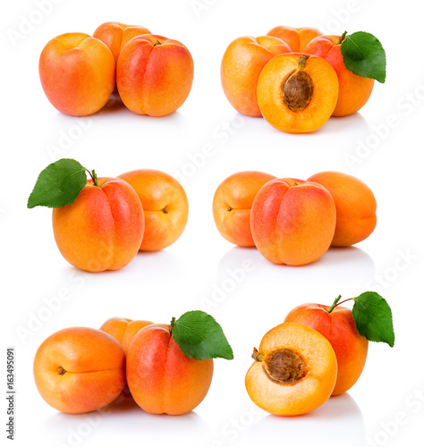 Set of ripe apricot fruits with with green leaf and slice isolated on white