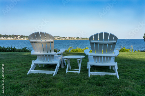 Adirondack chairs relaxing near the ocean in Newport, Rhode Isla Canvas Print
