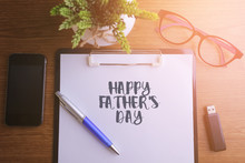 Business Concept - Top View Notebook Writing Happy Fathers Day.