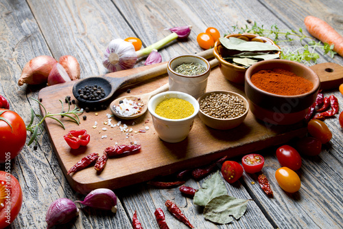 Aluminium Prints Spices and vegetables on wooden board