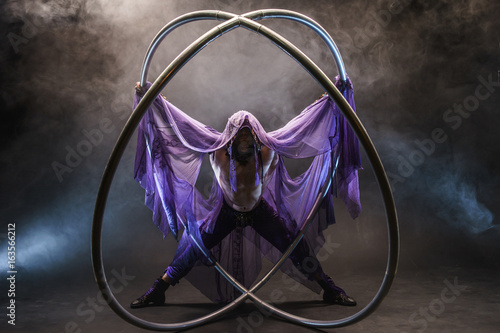 Fairy-tale character assassin in a purple cloak with a hood with two large cyr w Canvas Print