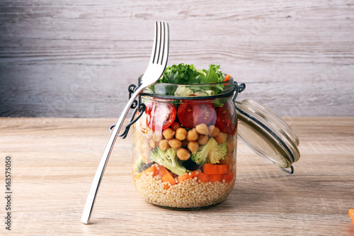 Fényképezés  Homemade salad in glass jar with quinoa and vegetables