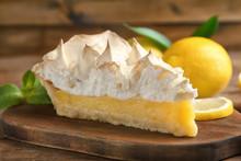 Piece Of Yummy Lemon Meringue Pie On Wooden Table