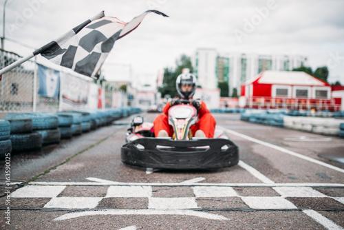 Poster Motorise Carting racer on start line, front view