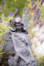 A Fairy Statue In A Garden Of ...