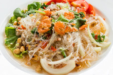 Thai Salad With Glass Noodles Prawns And Peanuts On Top With Chicken Meat In A Bowl Close-up, Spicy Salad(Yum Woon Sen)