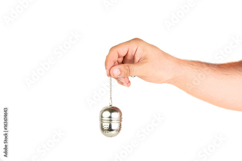 Fényképezés  Hand Holding Tea Container Isolated On White Background