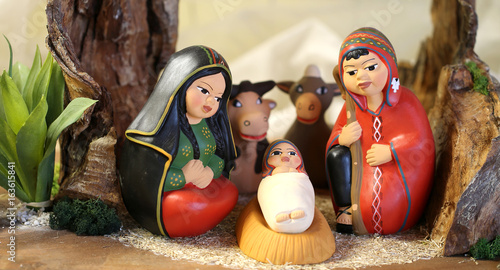 Photo Stands South America Country Peruvian holy family with South America dressed with two animals