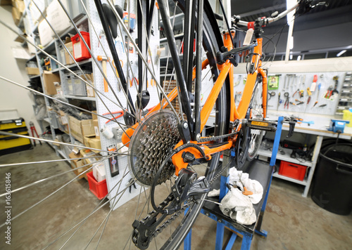 Fotografie, Obraz  orange bicycle in the mechanical workshop specializing in bike r