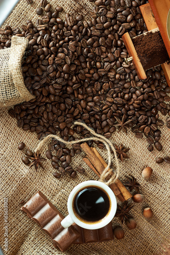 Fotografie, Obraz  Fragrant black coffee and cinnamon with chocolate and nuts on burlap