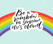 Be A Rainbow In Someone Else's Cloud. Positive Inspiration Quote With Rainbow At Blue Sky Background