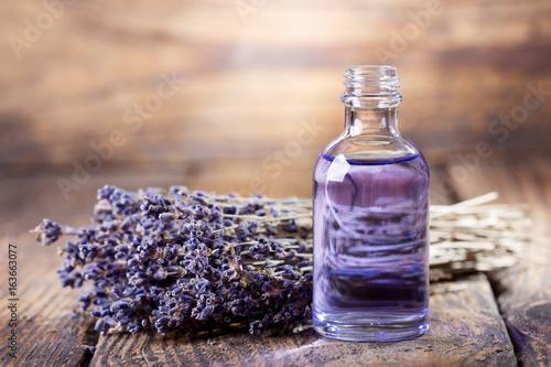 Fototapeta glass bottle of lavender essential oil obraz