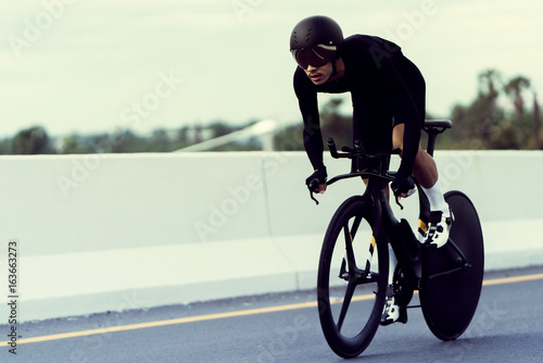 Asian men are cycling time trial bike in the morning Fototapeta