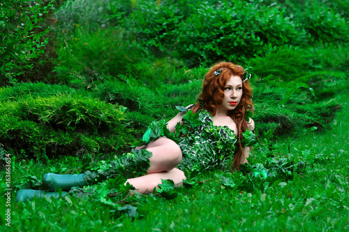 Fotografie, Obraz  Young beautiful red-haired girl in the image of the comic book poison ivy