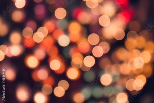 Vintage tone bokeh on dark romantic magic night background colorful.