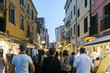 """Venice, Veneto, Italy. May 21, 2017: People strolling down the street called """"Rio Tera Lista D'espagna"""" at dusk"""